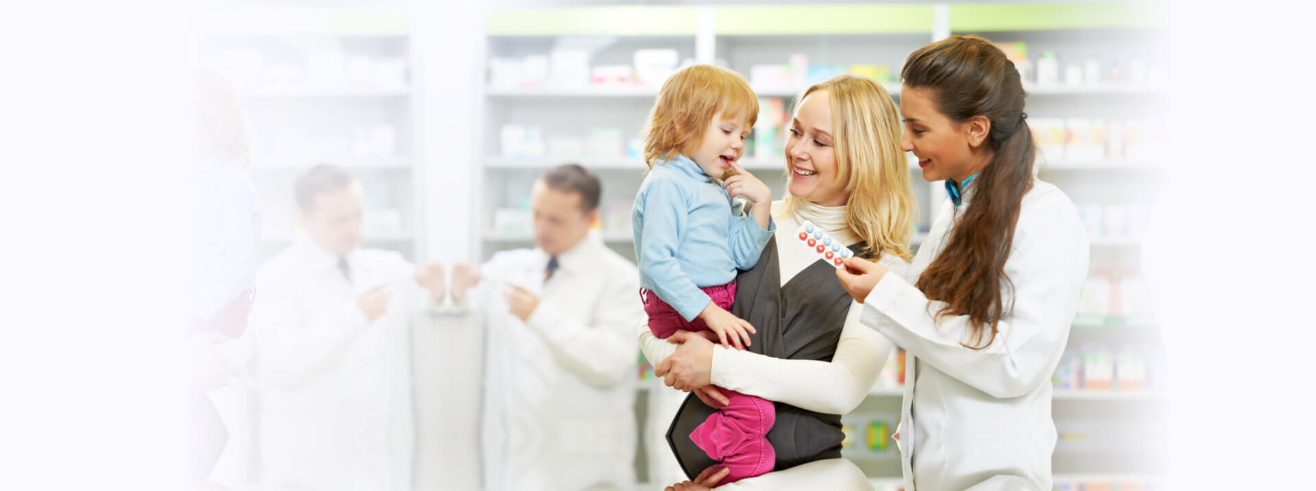 A pharmacist giving medicine to the child