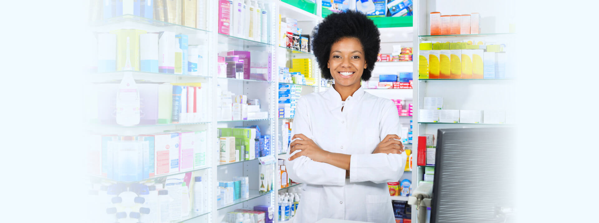 A pharmacist standing while smiling