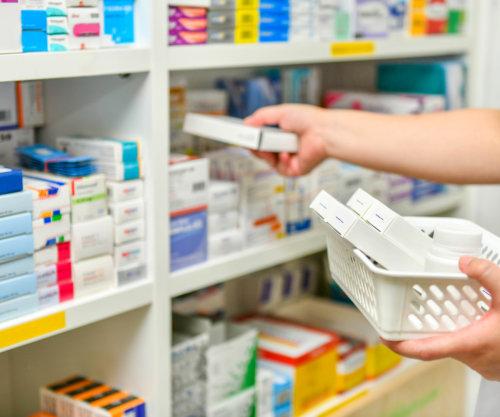 Pharmacist filling prescription in pharmacy drugstore