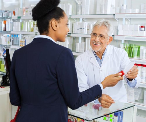 A customer asking about a medicine to a pharmacist